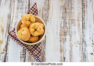 Donut in ceremic bowl on wooden background
