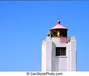 light house with a blue sky in the background