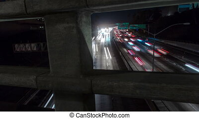 Freeway Tracking Time-lapse - The camera moves along a...