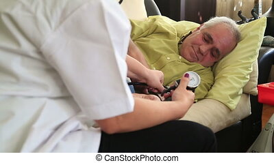 Female doctor checking  blood press