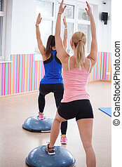 Women training with bosu ball - Photo of women training with...