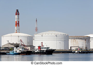Oil tanks in sea port - Industrial fuel storage tanks at oil...