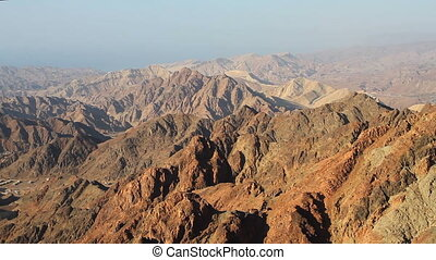 Sunrise over Red sea - Early morning in ancient mountains of...