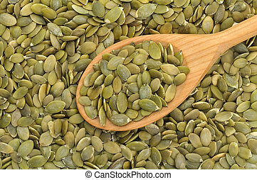 Pumpkin seeds with spoon - Wooden spoon filled with pumpkin...