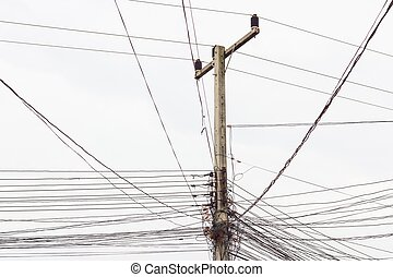 electric post with messy wires on white sky