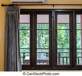 Closed window with curtain - Closed glass window with...