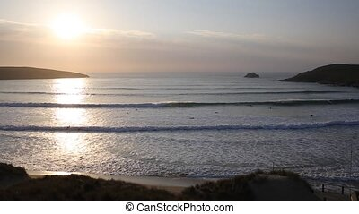 Sunset in Cornwall with surfers
