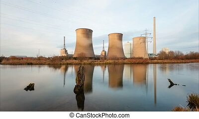 Power Station By River - A coal-fired power station in river...