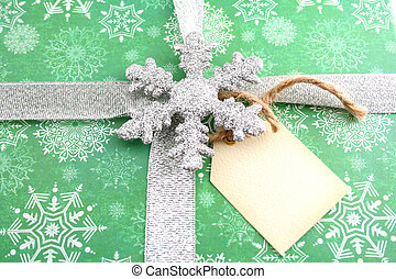 Christmas Gift - Christmas gift with silver ribbon and a...