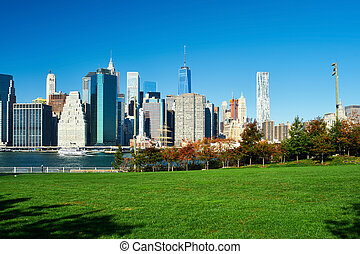 Lower Manhattan skyline view from Brooklyn Bridge Park in...