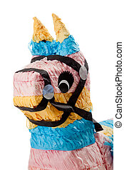 Pink, blue and yellow burro pinata on white - A pink, blue...