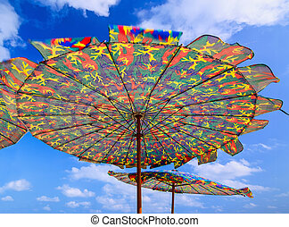 Colorful umbrella on the beach in sunny day.