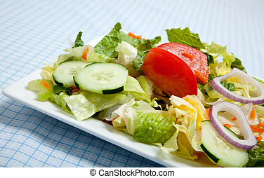 Tossed Salad on a plate with a fork - Tossed salad with...