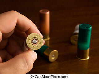 Caliber - Hunter shows the caliber of hunting cartridges