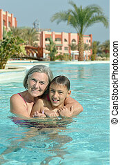 Grandma and grandson in pool - Happy smiling grandma and...