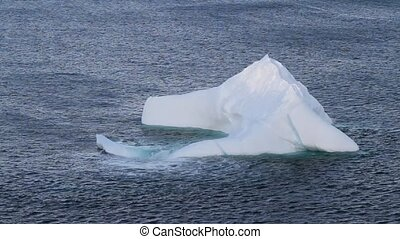 Atlantic Canada Iceberg - Waves washing over an iceberg.