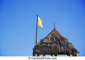 Sousse - yellow flag on the beach in Tunesia