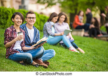 Students outdoors - Couple of attractive smiling students...