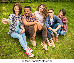 Students outdoors - Group of young attractive smiling...