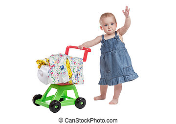 Shopping cart full of clothes and baby - Little girl in...
