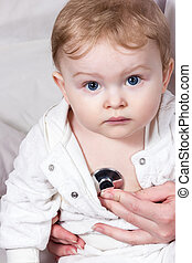 Stethoscope listening to a baby heart beat - Portrait of a...