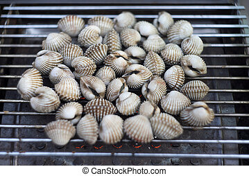 Cockles on flaming grill
