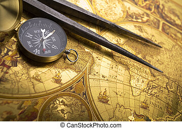 Compass on map - A beautiful golden compass on an old map