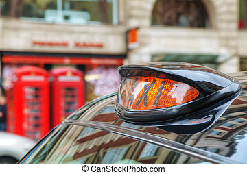 Famous black cab on a street in London - Famous taxi cab...