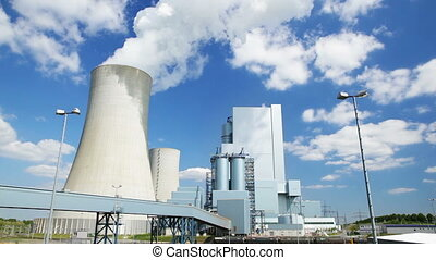 Power Station And Blue Sky - Time lapse sequence of a modern...