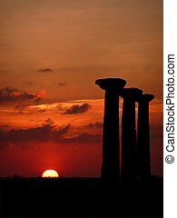 Pillars at sunset - Three ancient pillars highlighted...