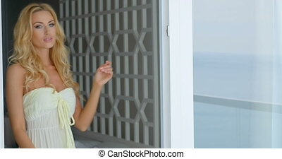 Sensual Blond Woman Leaning Against Glass Door - Alluring...