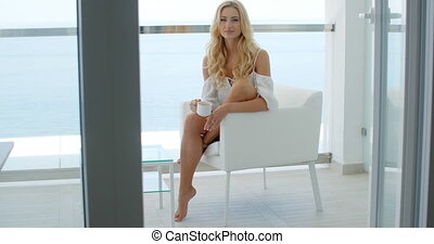 Blond woman on the balcony of a luxurious hotel - Relaxed...