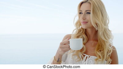 Blond Woman Looking to the Side in front of Ocean - Blond...