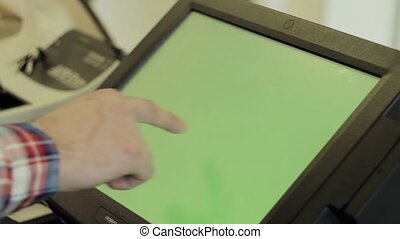 Tablet with green screen at checkout