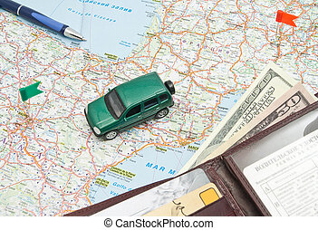 green car, pen and wallet on the map