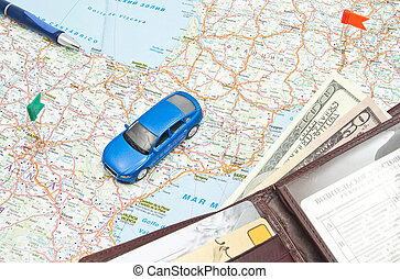 wallet, pen and blue car on the map of Europe