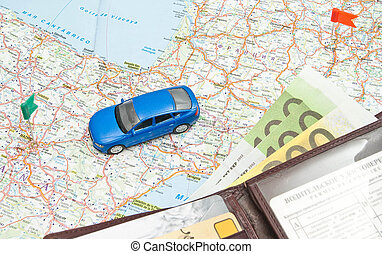 blue car and wallet on the map