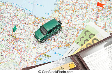 green car and wallet on the map of Europe