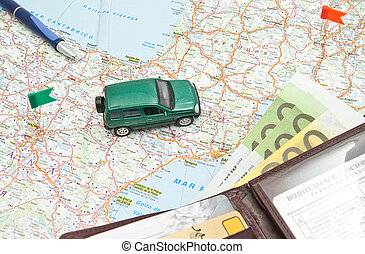 green car, wallet and pen on the map