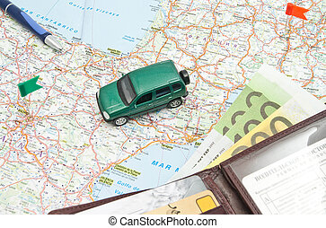 wallet, pen and green car on map of Europe