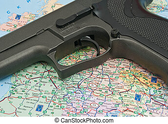 gun over the map of Europe closeup