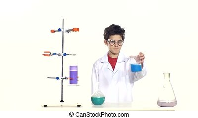 Young boy chemist wearing uniform, red shirt and round...