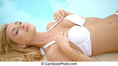 Woman in White Bikini Lying Next to Swimming Pool -...