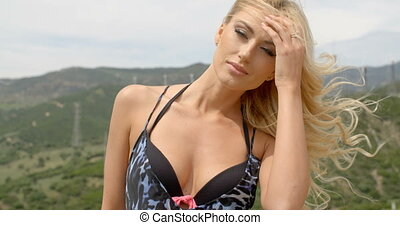 Blond Woman on Windy Hill near Wind Farm - Attractive Blond...