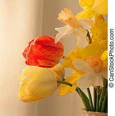 Daffodils and Tulips - A photograph of a bouquet of bright...