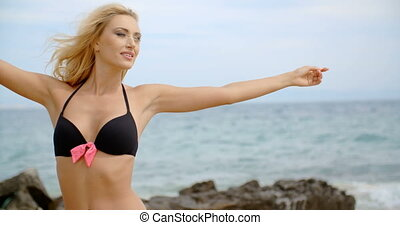 Woman Wearing Bikini with Open Arms at Beach - Blond Woman...