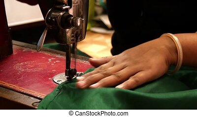 Asian seamstress at work - an Asian artisan in her...