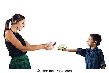 Gentleman child - Child as a gentleman gives a flower
