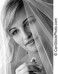 Smiling bride wearing veil
