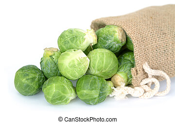 brussel sprouts fall out bag on white background